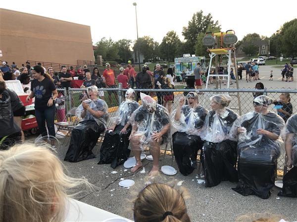 Staff having pies thrown at them